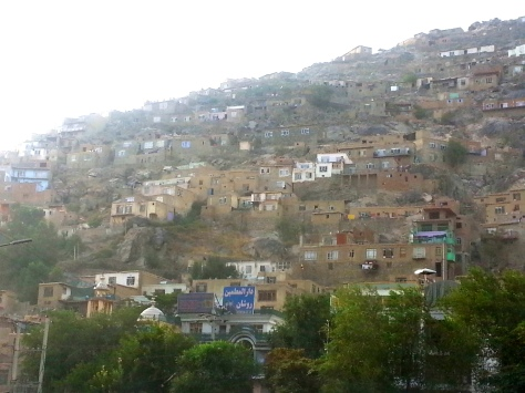 Kabul  hillside across from center of town. Home built here are significantly less expensive than the homes built on flatter ground. Images © 2013 Rebecca Martin