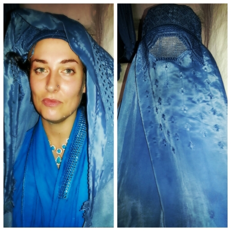I was excited to try on an Afghan Burqa. A burqa (Urdu: بُرقع‎), (Arabic pronunciation: [ˈbʊrqʊʕ, ˈbʊrqɑʕ]a (also transliterated]burkha, bourkha, burka or burqu' from Arabic: برقع‎ burquʻ or burqaʻ), also known as chadri or paranja in Central Asia) is an enveloping outer garment worn by women in some Islamic traditions to cover their bodies when in public. Info Source http://en.wikipedia.org/wiki/Burqa Images © 2013 Rebecca Martin
